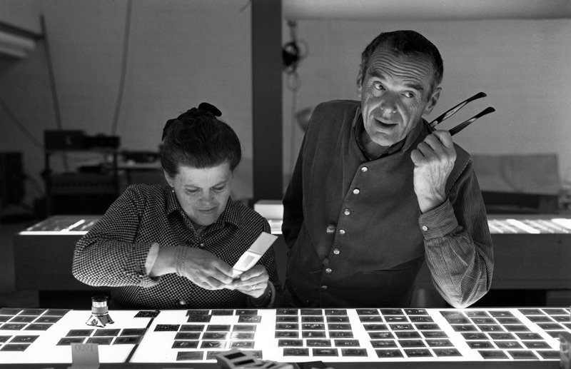 1. The World of Charles and Ray Eames. Charles and Ray Eames selecting slides